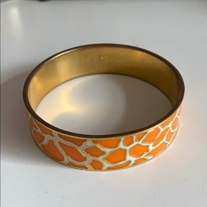 "Orange and White Kate Spade ""Stand Tall"" bracelet"